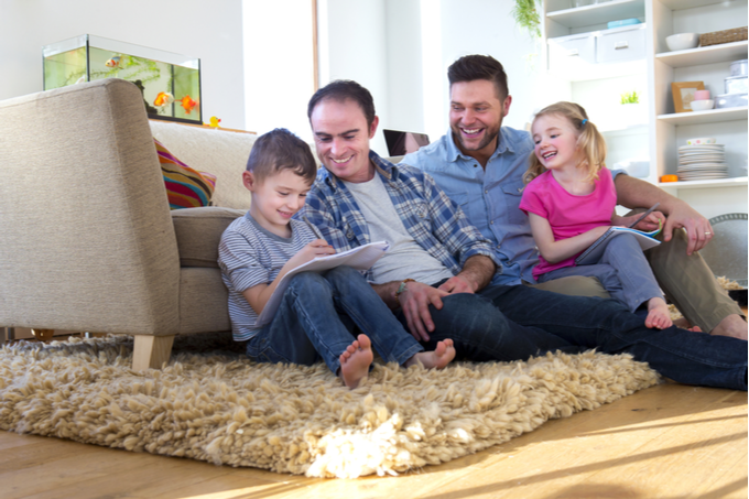 Brown lawyers blog, planning for their future, image of two dads sitting on the floor with their children having fun